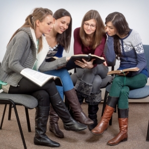 16881664 - young woman teacher teach god's words to a women team